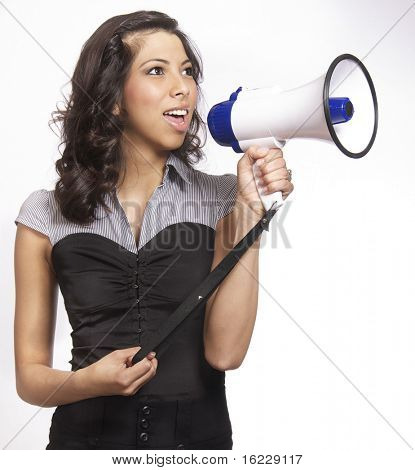 Confident young woman making announcement over loud speaker bullhorn,