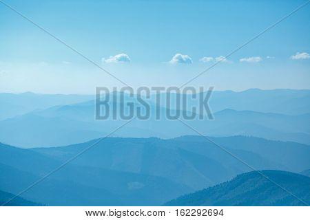 Layers of ridges in Carpathians Mountains Ukraine at sanrise sky