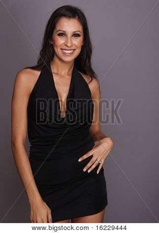Beautiful charming happy elegant young woman wearing black dress.