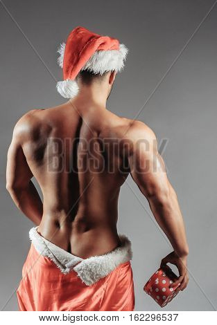 Naked Muscular Man With Santa Coat