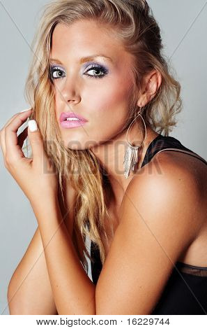 Fashion and beauty head and shoulder photo of beautiful blond woman