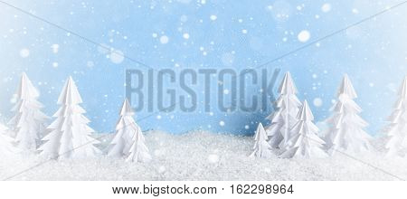Winter Christmas Minimalist Background Frosty Baner With White Paper Trees On Blue .