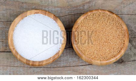 White and beige sugar in a bowls on table