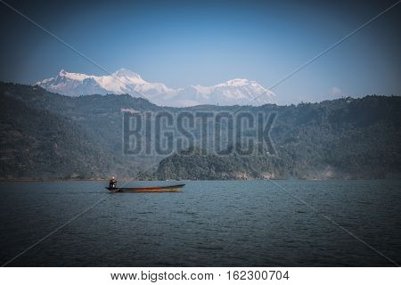 Lake Phewa in Pokhara Nepal with the Himalayan mountains in the background including Machhapuchhre and Annapurna