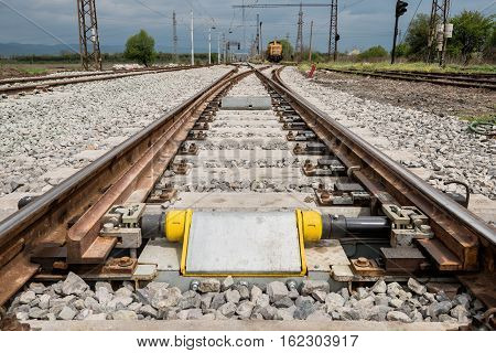Railroad tracks closeup with derailing block in foreground
