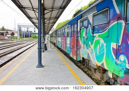 Old train painted by vandals in italian station (Italy-Tuscany-Lucca)