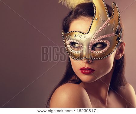 Expressive Female Model Posing In Carnival Mask With Red Lipstick And Looking Vamp On Empty Copy Spa