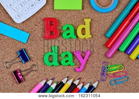Bad day words on cork background closeup