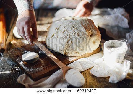 Close Up View Of Baker Kneading Dough. Homemade Bread. Hands Pre
