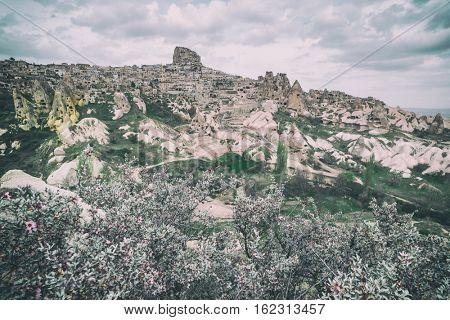 Uchisar castle in Cappadocia, Turkey. Toned like Instagram filter