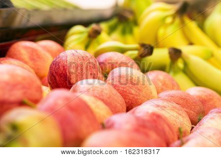 Apples And Bananas On Sale At Grocery Market,