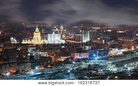 View from the roof tops in the winter on night city Moscow.