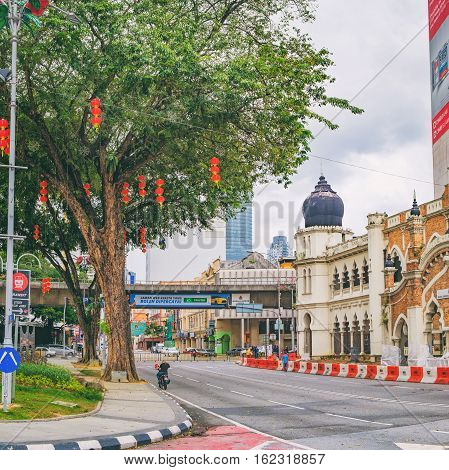 Kuala Lumpur, Malaysia - February 7, 2016: Cityscape Jalan Raja and part of the facade of Panggung Bandaraya City Theatre in Kuala Lumpur, Malaysia. It is located in the tourist center of the city.