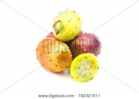 Colored and fresh prickly pears on white background
