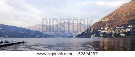 A winter wide-angle view of Como Lake, from Como city lakeside. Color image.