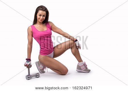 Beautiful sexy fitness woman in panties - posing with dumbbells. Isolated on the white background.