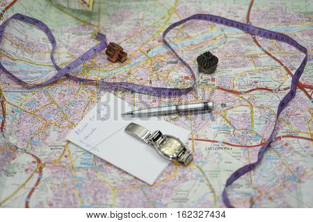 Planning route of city visiting. Big map on table with equipment