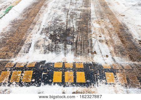 Speed Bump In Snow On Urban Road In Winter