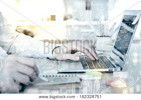 Creative filtered image of businessman using laptop at workplace. Side view. Technology and communication concept