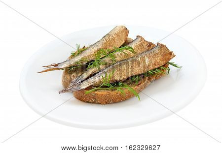 Sprats sandwiches on a plate on isolated on white background