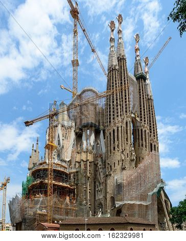 Cranes Are Over Sagrada Familia Towers In Barcelona, Catalonia, Spain.