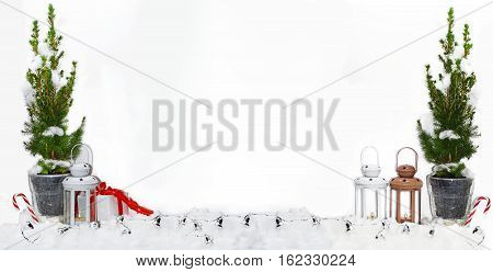 Composition of Christmas tree and lights in snow. Isolated on white background.