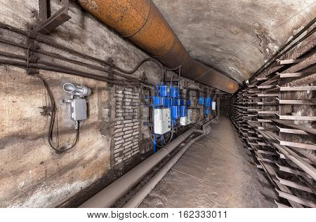 Electrical cabinets and other equipment in underground communication tunnel