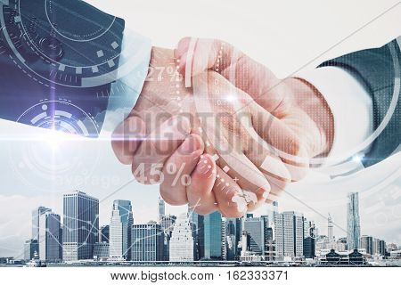 Close up of handshake on abstract city background with digital pattern. Double exposure. Business concept