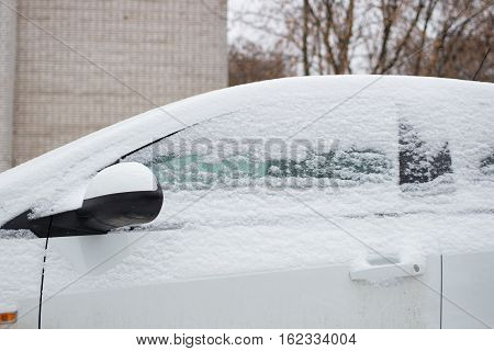 The car filled up by snow in the daytime