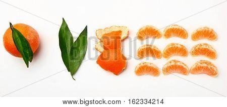 Gradual peeling of tangerine on white background.