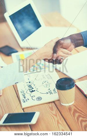 Business people handshake sitting on the desk in office