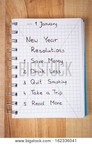 New Years Resolutions Written In Notebook