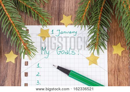 Pen And Notebook For Planning New Years Resolutions And Goals