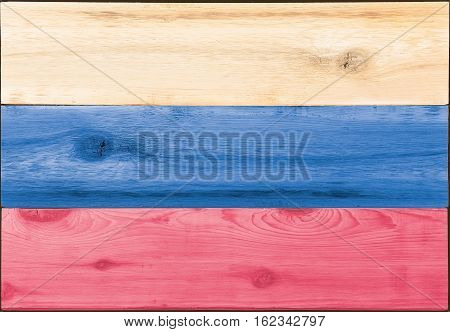 Timber planks of wood that have been painted or stained in the colors of a flag of Russia as a background