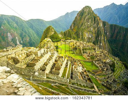Machu Picchu, peruvian lost city of Incas situated on mountain ridge above Sacred Valley of Urubamba River in Cusco Region, Peru. UNESCO World Heritage and one of the New Seven Wonders of the World