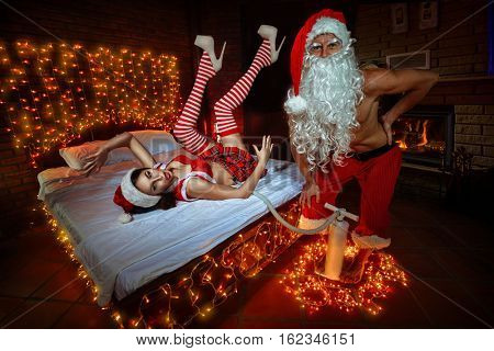 Santa Claus blowing-up inflatable doll for Christmas. The bed is beautifully decorated for Christmas.