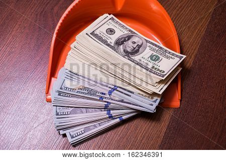 money in the scoop shovel broom and money business plan money background hundred dollar bills front side. background of dollars revenge money earn a lot
