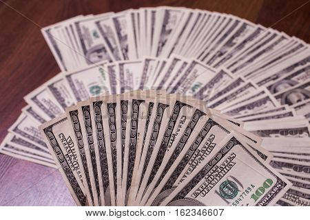 fan of money a fan of new hundred dollar bills hundred dollar bills face thirst for wealth detail renting pocket money money background Millionaire money in hand taking money