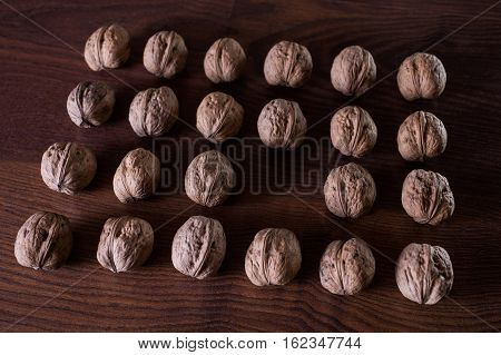 walnuts on a dark background conceptual photography walnuts lie in a row in a heap an extra player an interesting idea