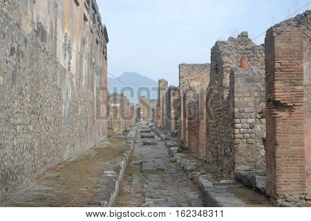 Residential street in Pompeii Italy with Mt Vesuvius in the back