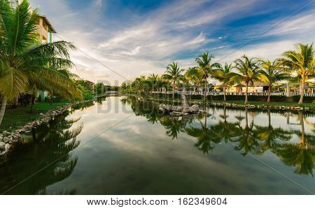Cayo Coco island, Memories Caribe resort, Cuba, June 28. 2016, amazing inviting gorgeous natural landscape view of Memories Caribe hotel grounds at sunset time