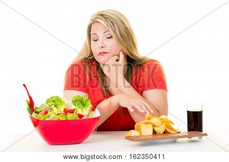 Woman With Choice Of Salad Bowl And Junk Food