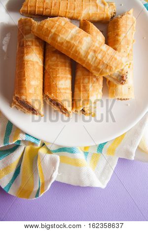 waffle rolls with chocolate filling in it