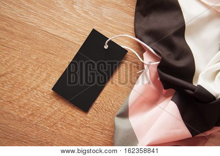 empty clothes` labels with vivid shadows on colorful background