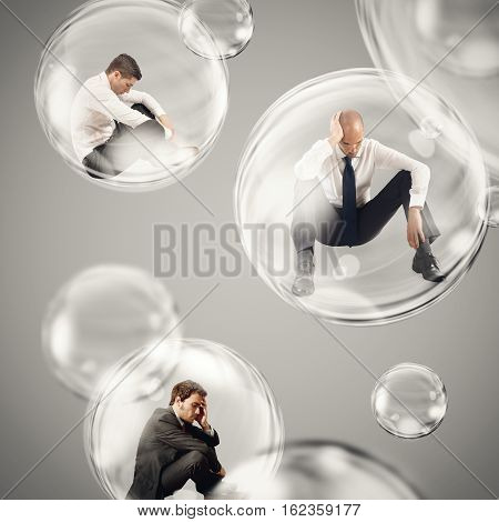 Sad businessmen flies in a bubbles. isolate themselves inside a bubbles detachment from the outside world concept