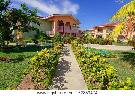 Cayo Coco island, Memories Carib hotel, June 30, 2016, amazing beautiful, gorgeous view of resort buildings and grounds against blue sky background on sunny day