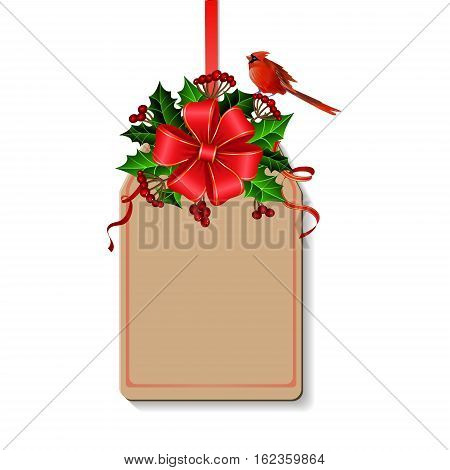 Christmas decoration with bow and holly and rowan berries and cardinal bird on tag with free space