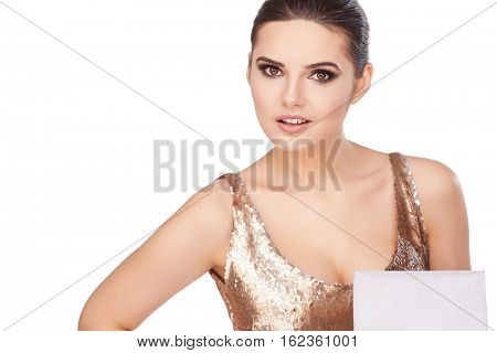 christmas, x-mas, happiness concept - smiling woman in golden dress with gift boxes
