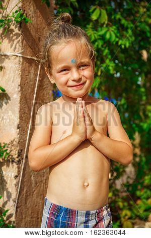 Very beautiful boy as a Buddha with a third eye