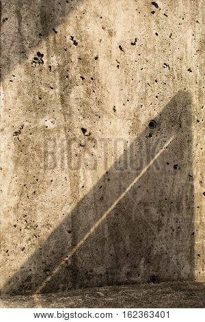 Interesting triangular shadow pattern on concrete wall